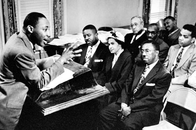 Martin Luther King Jr. outlines boycott strategies at a church meeting