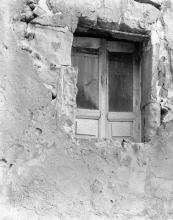 Taken from street level of a 2nd story  window